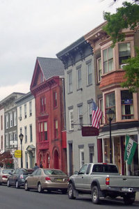 photo of Hudson NY architecture with parked vehicles and colorful buildings